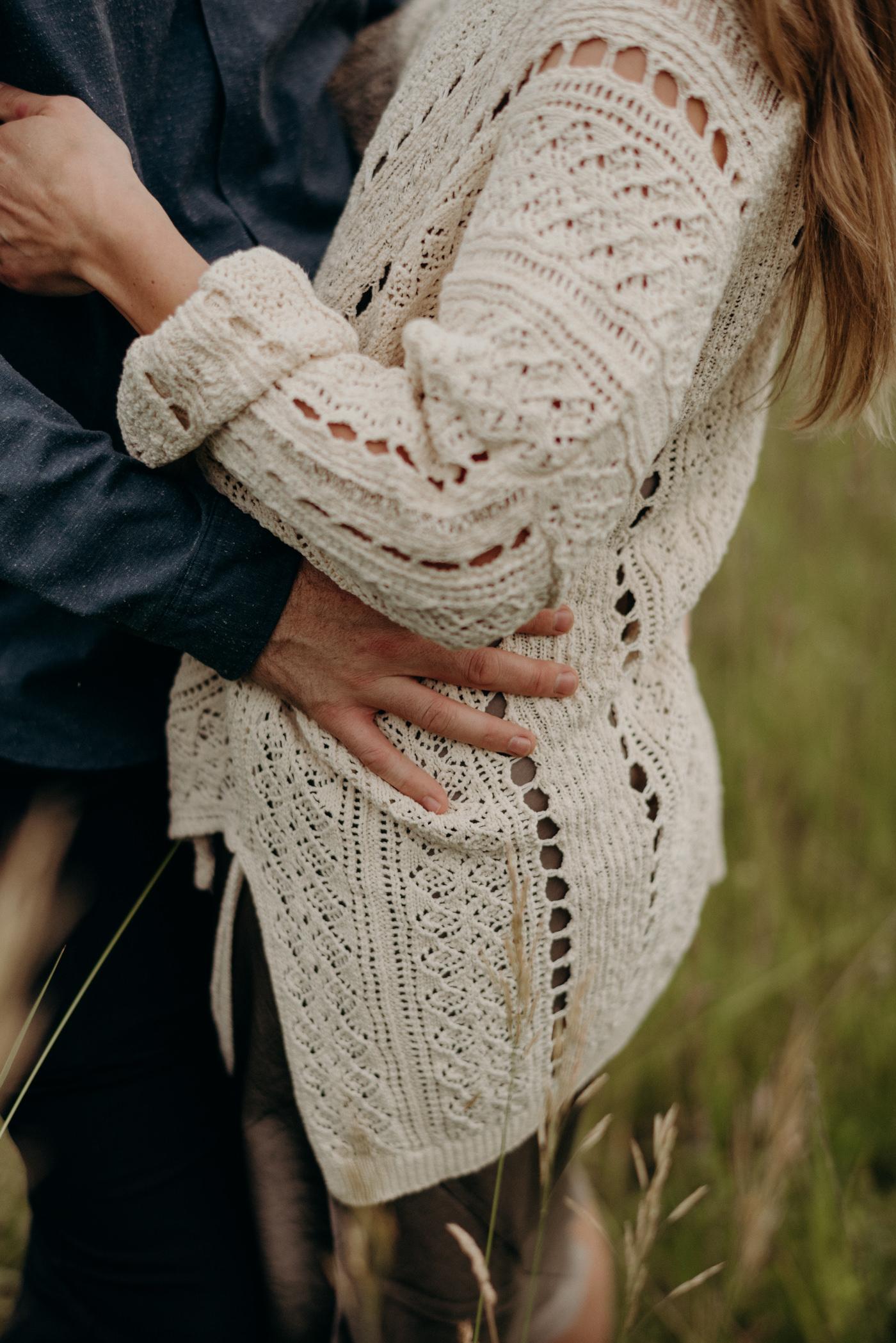 guy hugging girl in vintage sweater
