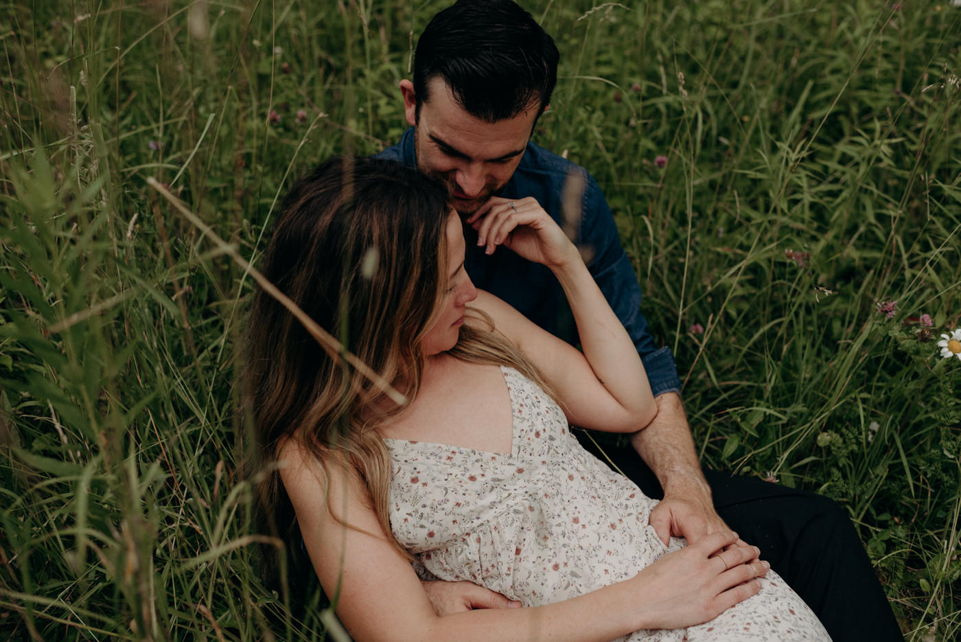 sweet warm summer night engagement shoot, girl lying in guys lap in tall grass