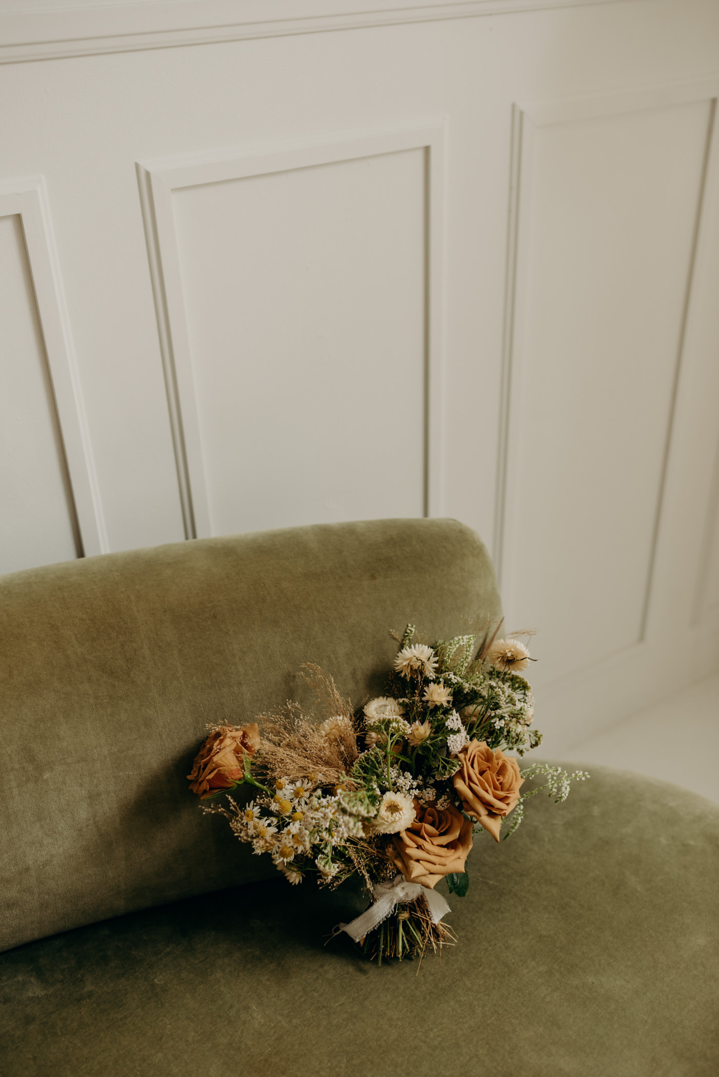 bouquet on green velvet touch at Lovt Studio East elopement