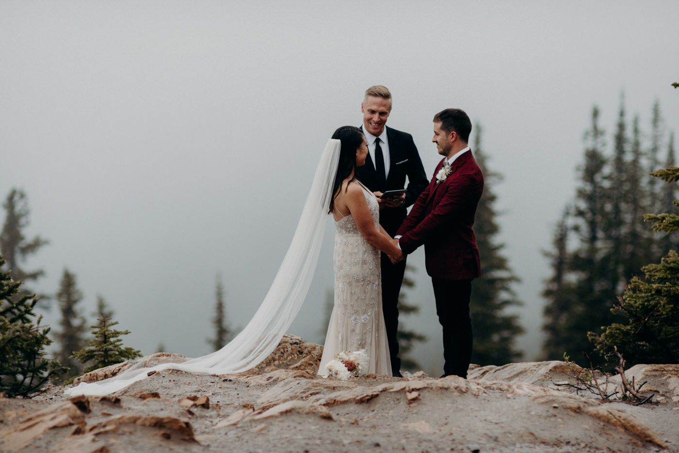 Rainy morning ceremony Banff National Park elopement