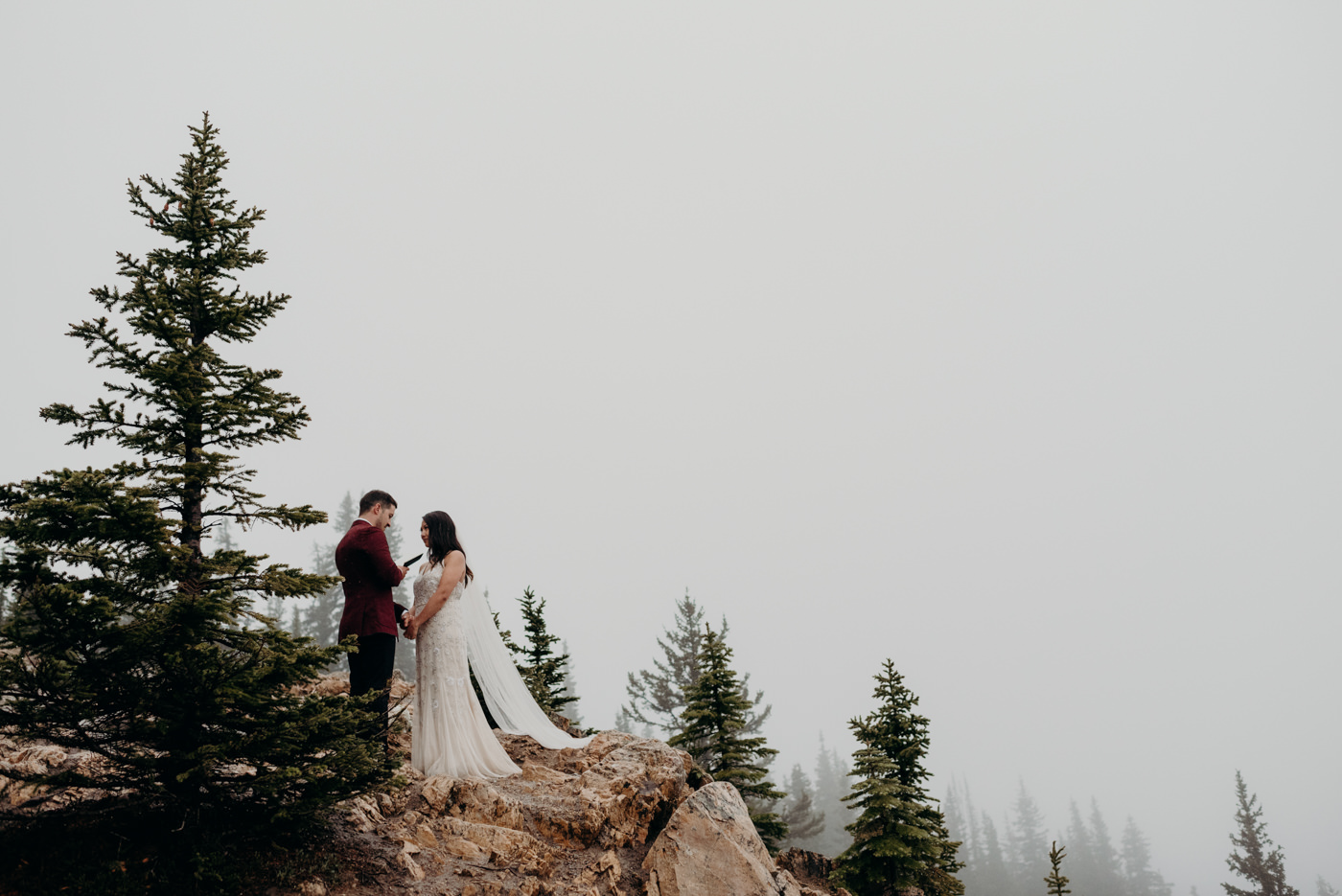 exchanging vows at Banff National Park Elopement