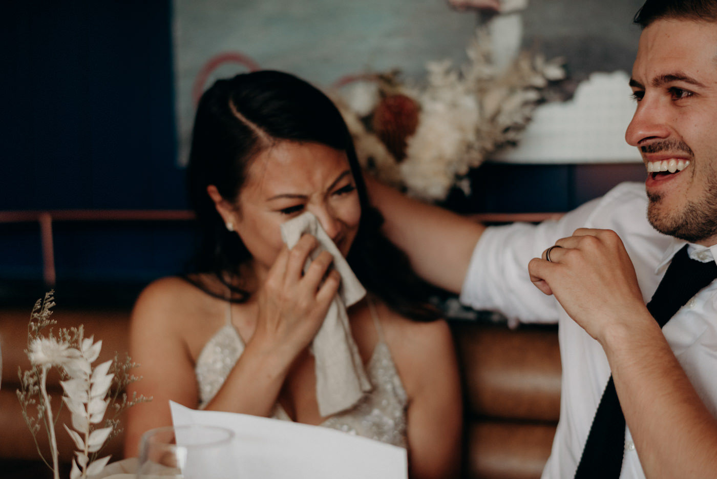 emotional bride reading letters from family on their wedding day