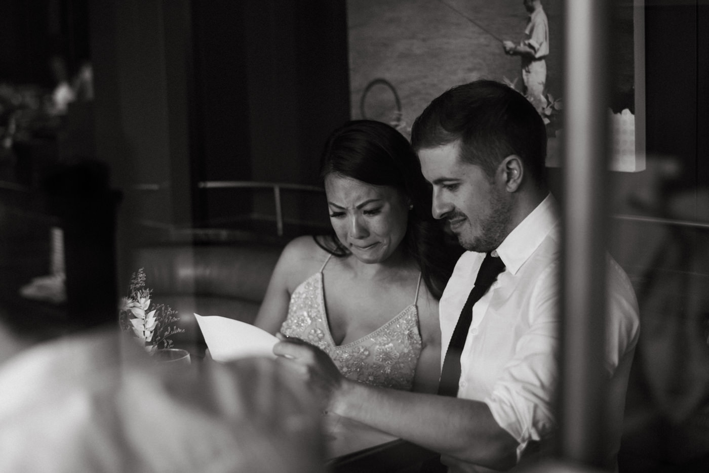 emotional bride crying as they read letters from family on their wedding day