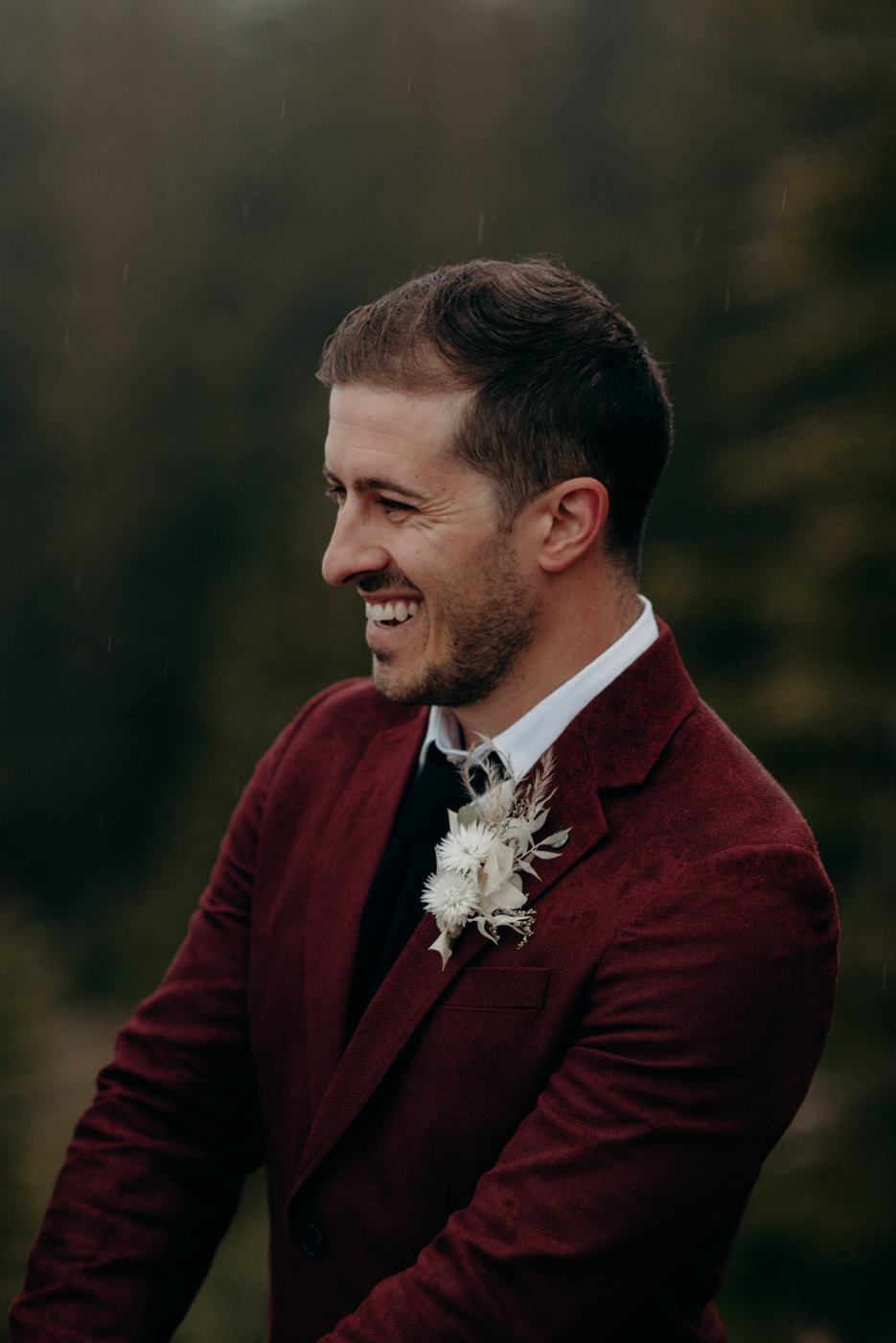 groom laughing during ceremony, Banff National Park elopement