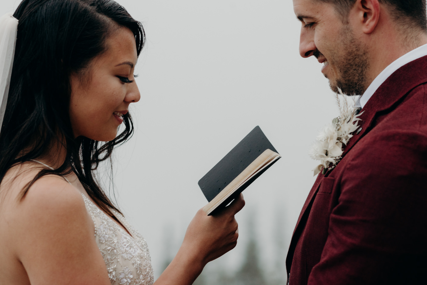 bride reading vows to groom, banff national park elopement