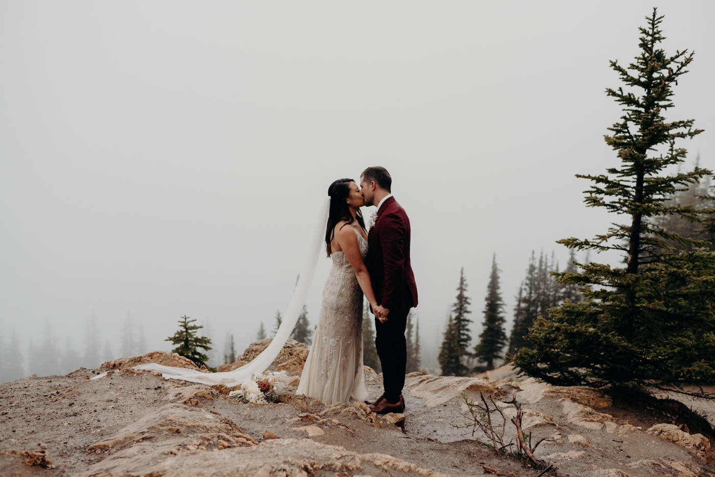 bride and groom kissing, banff national park elopement