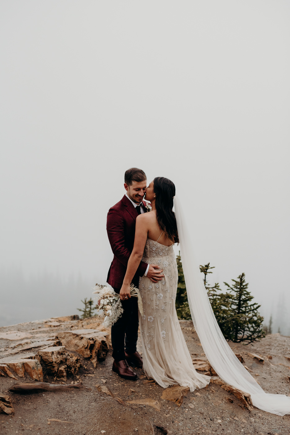mountain elopement, bride kissing groom on the cheek