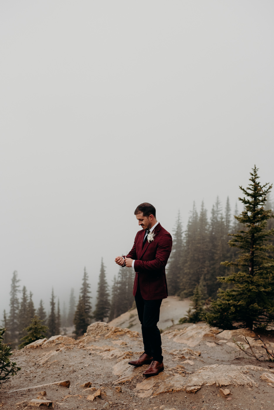 Groom standing on mountain edge, Banff National Park elopement