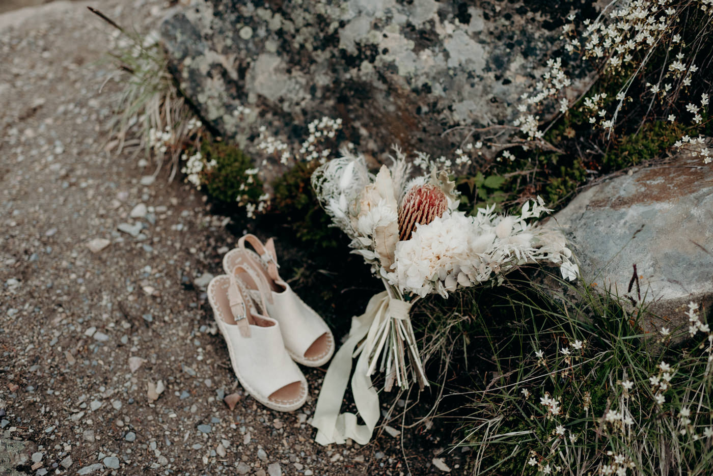 shoes and bouquet on the ground