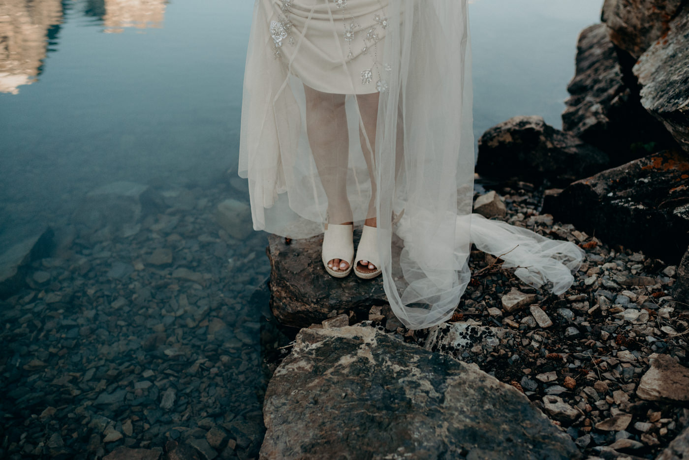 bride wearing Tom canvas wedges for mountain elopement