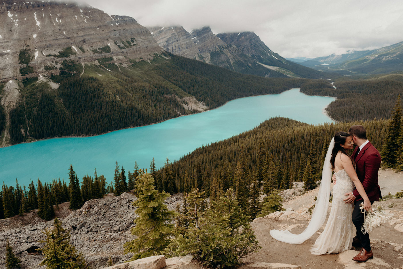 bride and groom hugging with Peyto Lake in the background, Banff National Park elopement