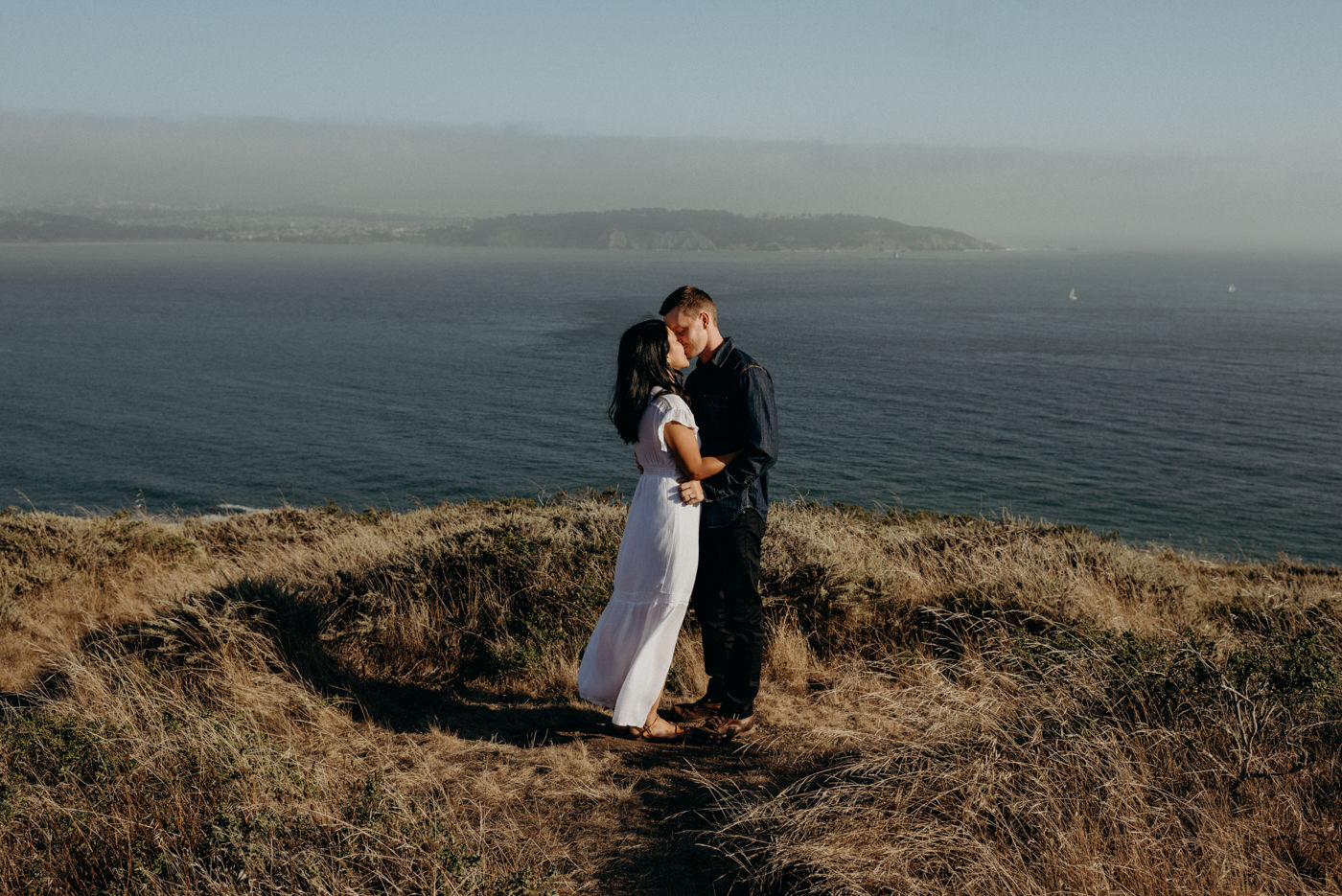 couple kissing at sunset at Marin Headlands Couple Shoot