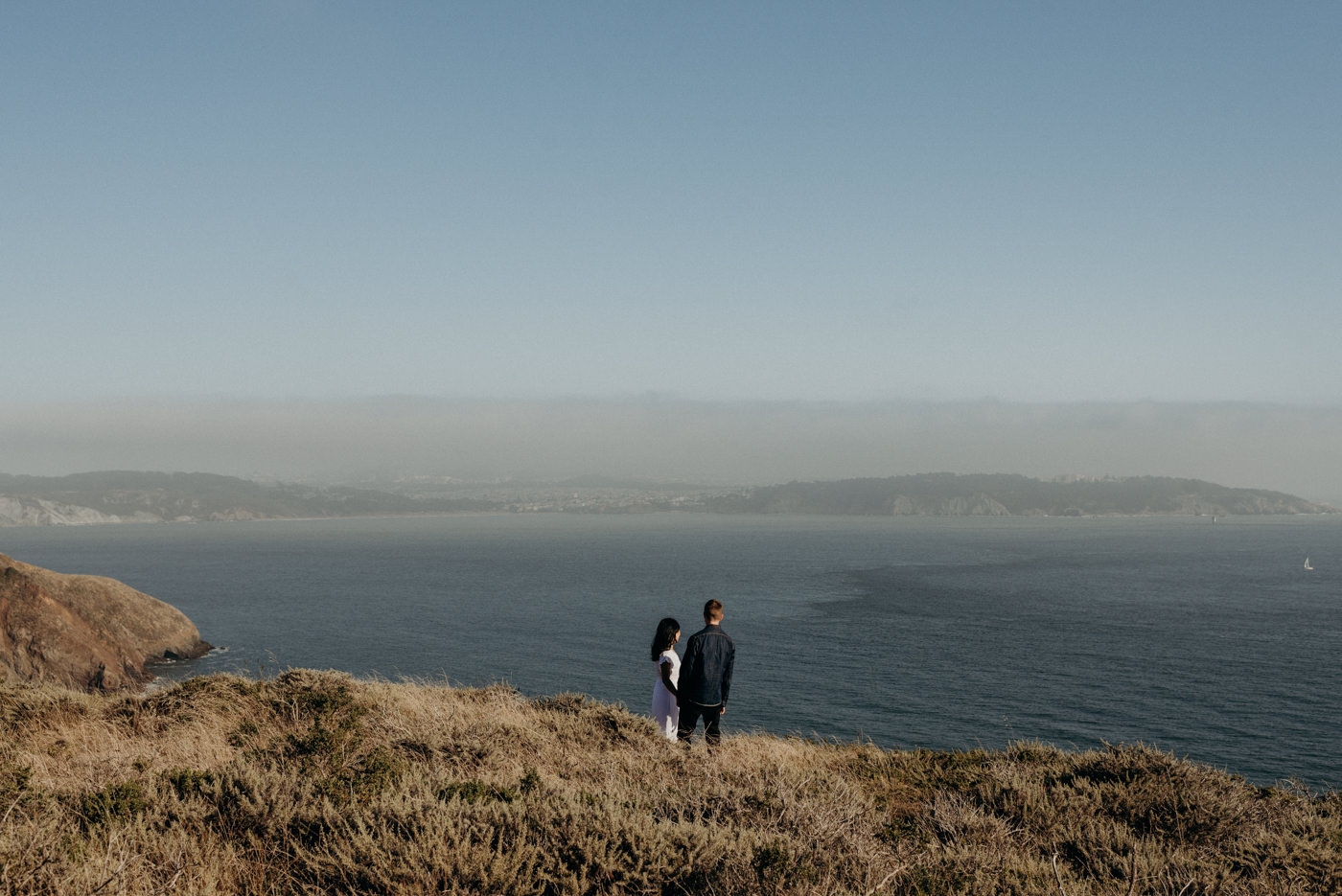 Couple looking off to ocean at Marin Headlands