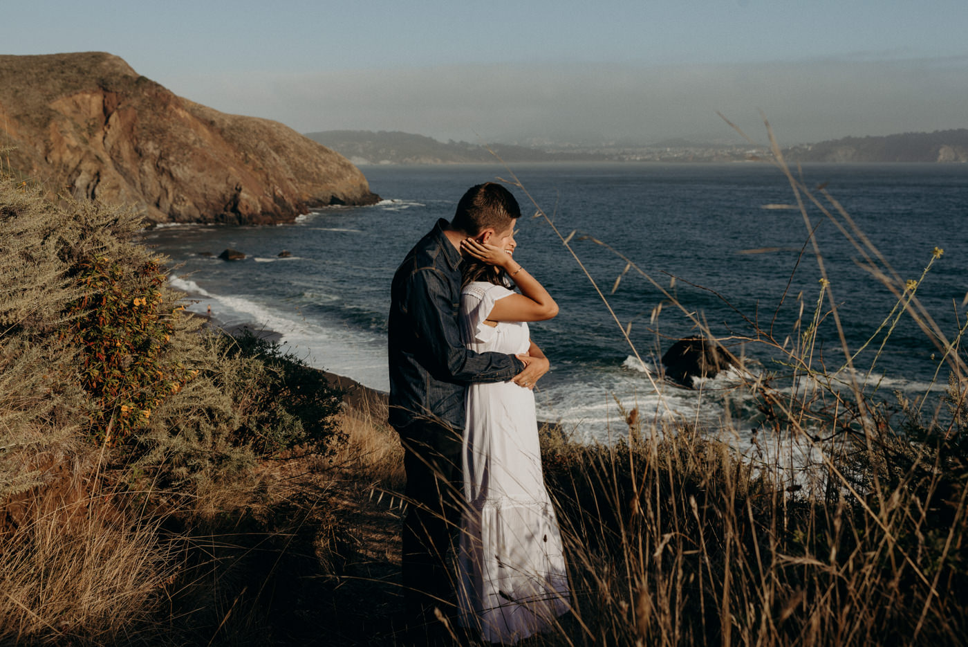 Couple hugging at Marin Headlands at sunset
