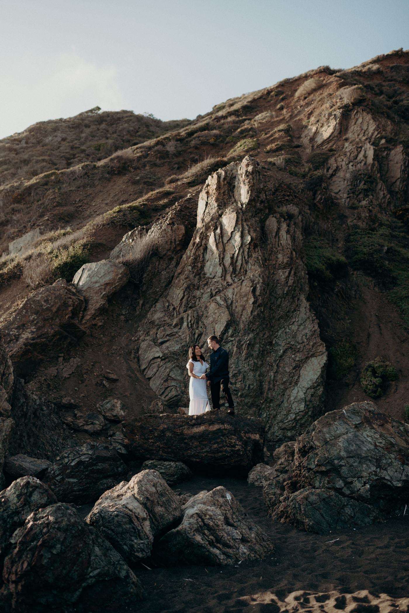 Couple standing on rocks at Marin Headlands
