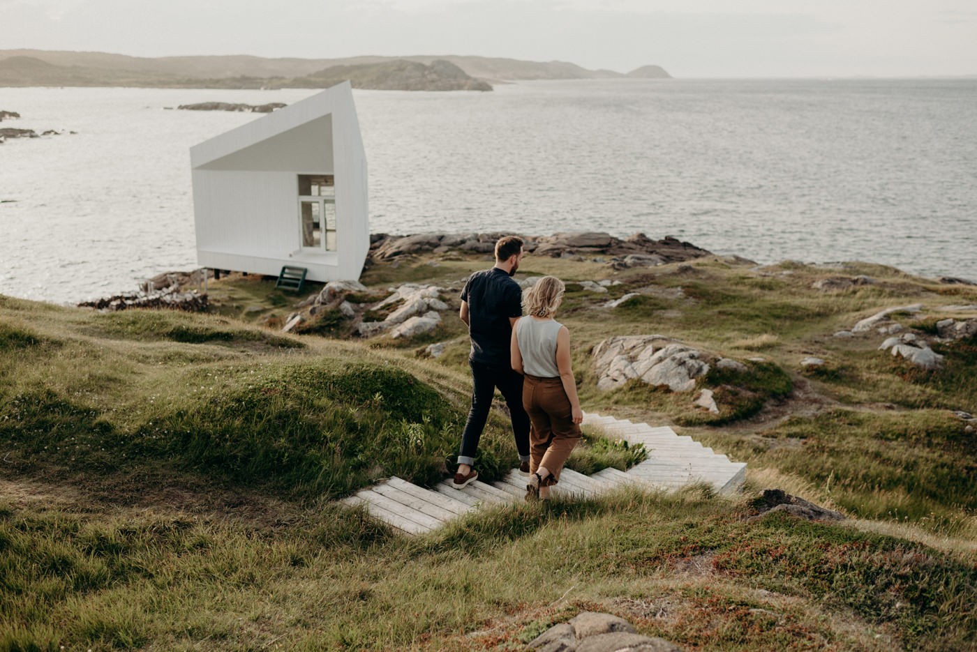 Couple exploring Fogo island and visiting Squish Studio
