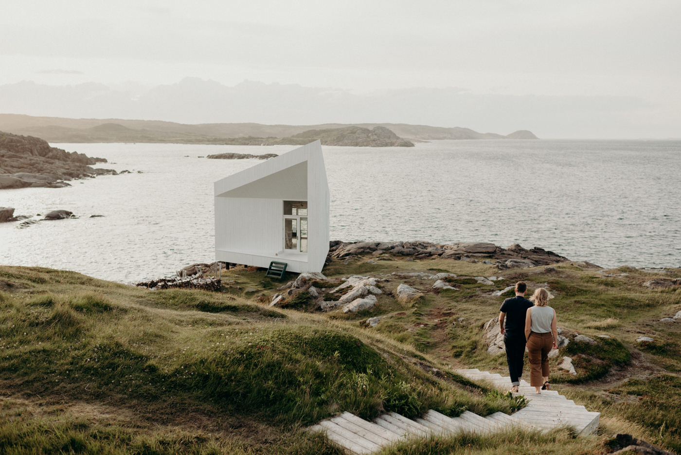 Couple walking on path to Squish Studio on Fogo Island