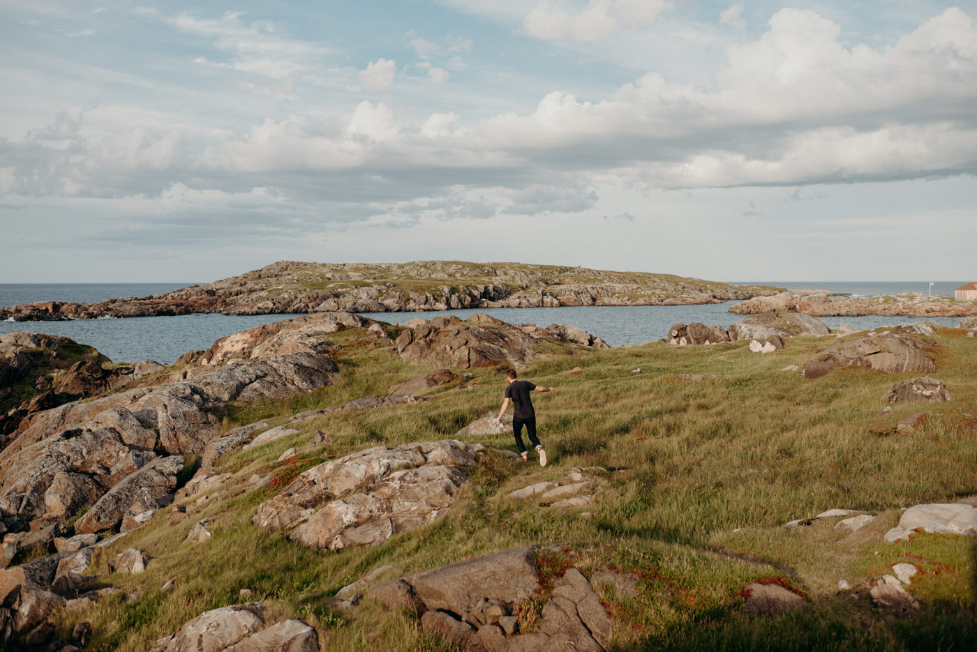 Guy running on rocks on fogo island