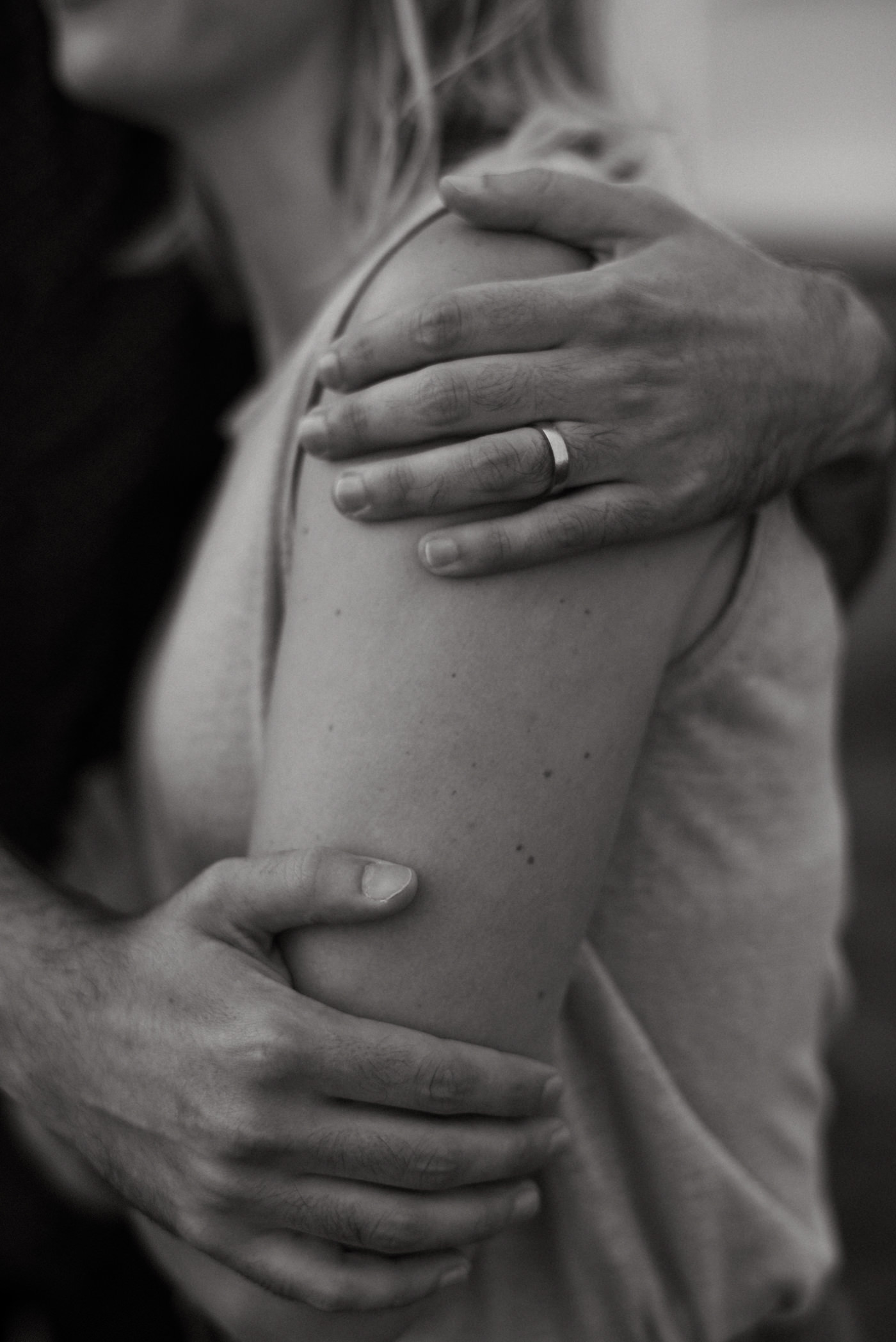 black and white images of husbands hands on wifes arm