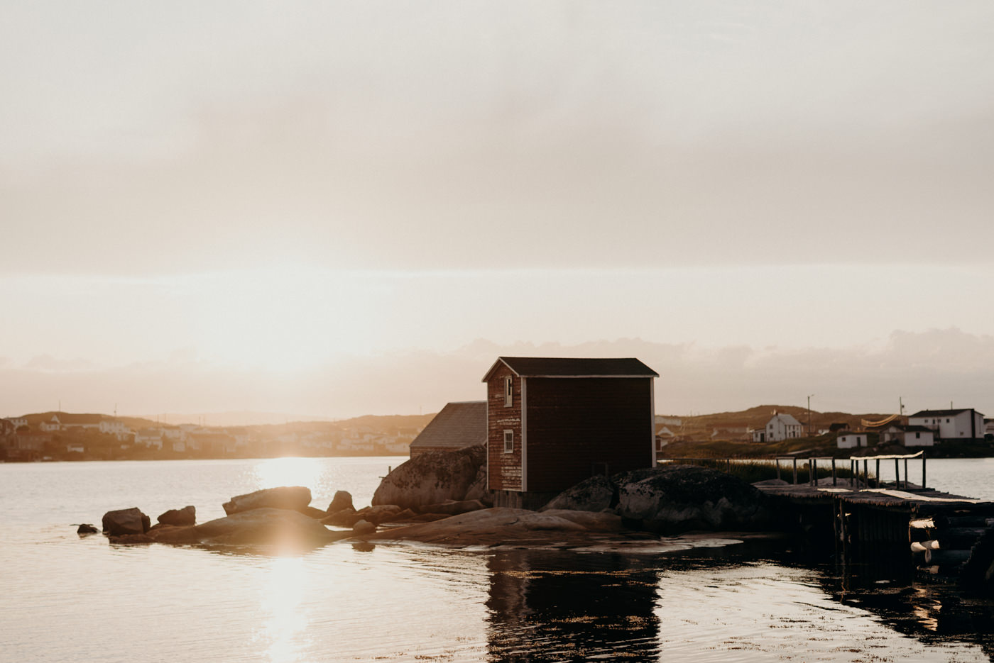 Sunset on harbour with fish shed in background in Tilting, Fogo Island