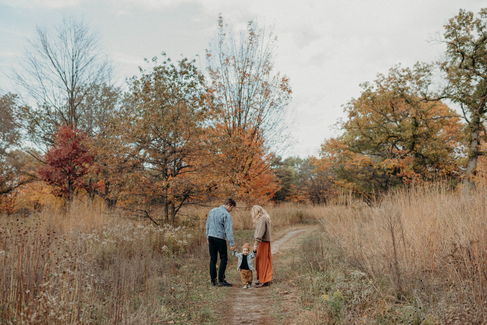 Young family in High Park during fall colours