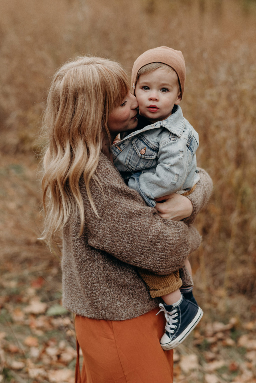 Mother hugging toddler son, fall portraits