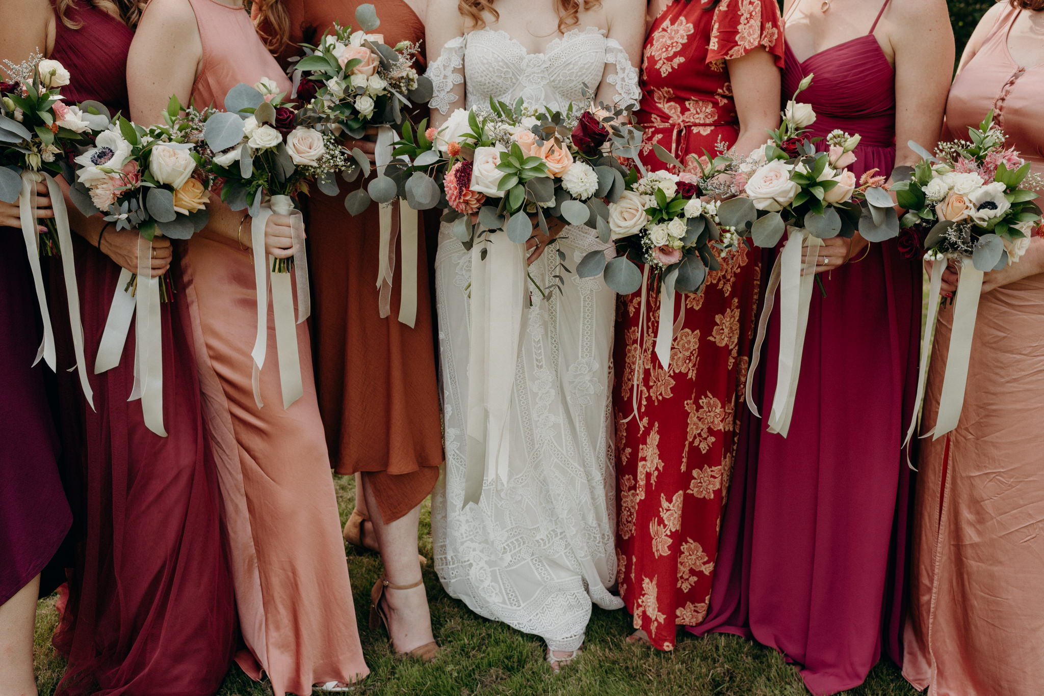 bridesmaids and bride holding bouquets
