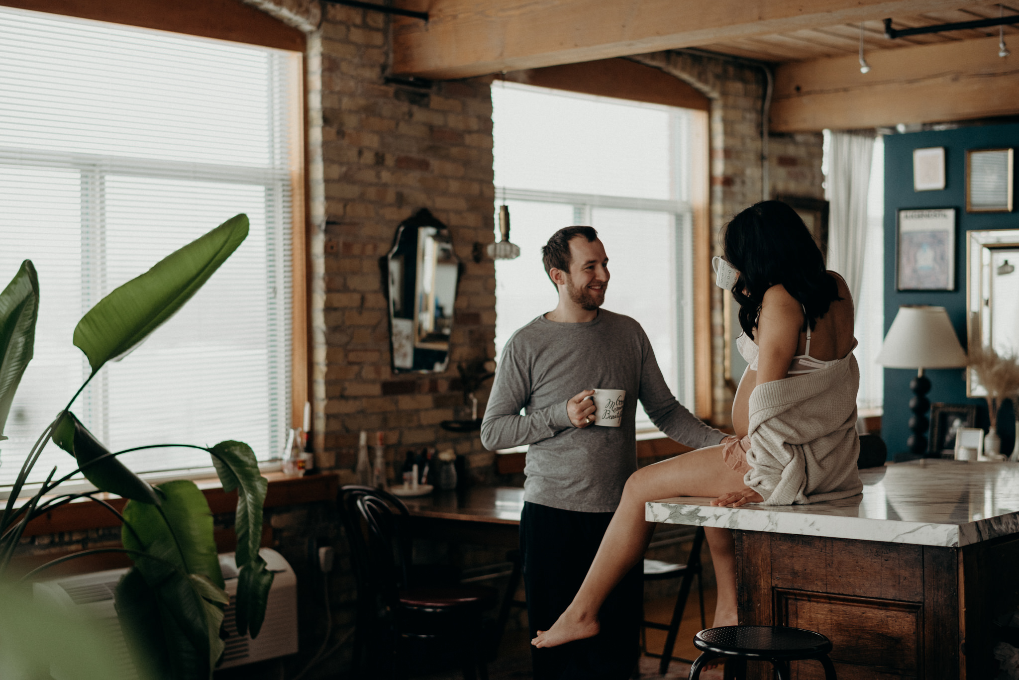 Couple drinking coffee in a loft