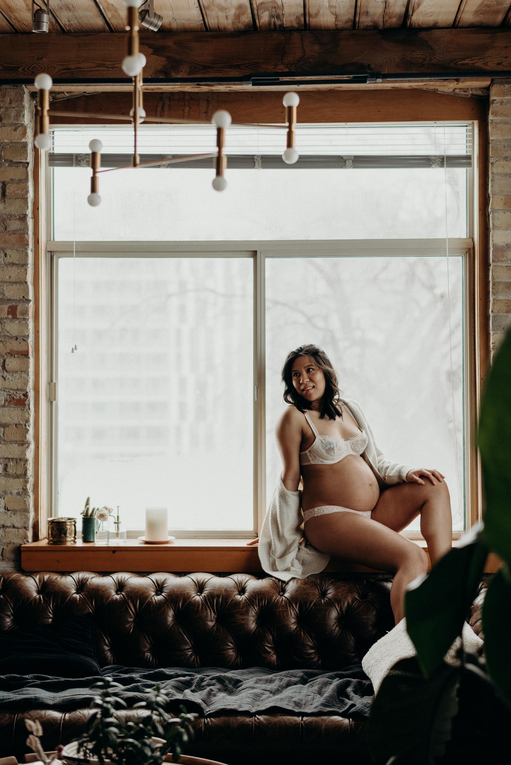 pregnant woman in lingerie in a trendy loft