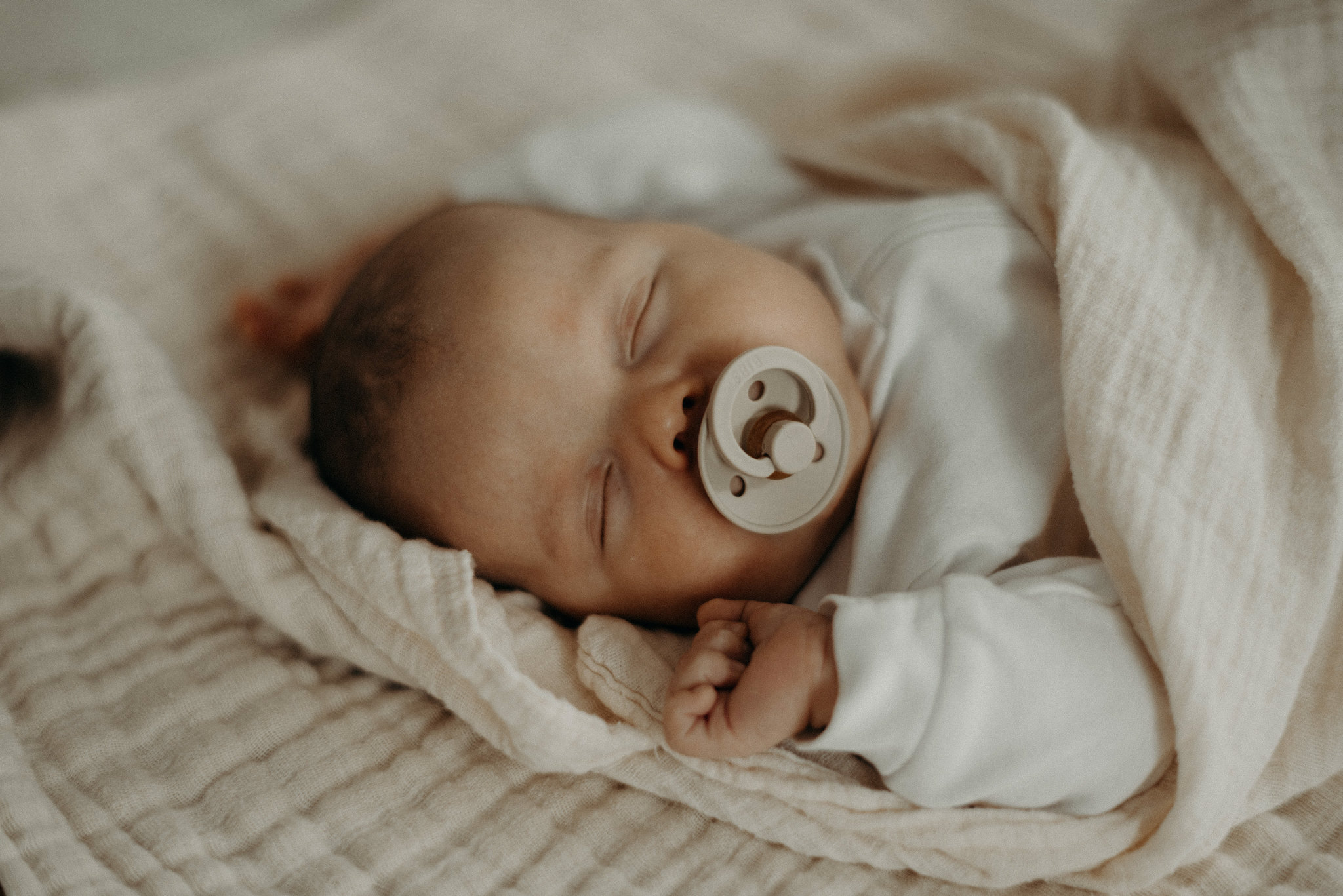 baby sleeping with bibs pacifier