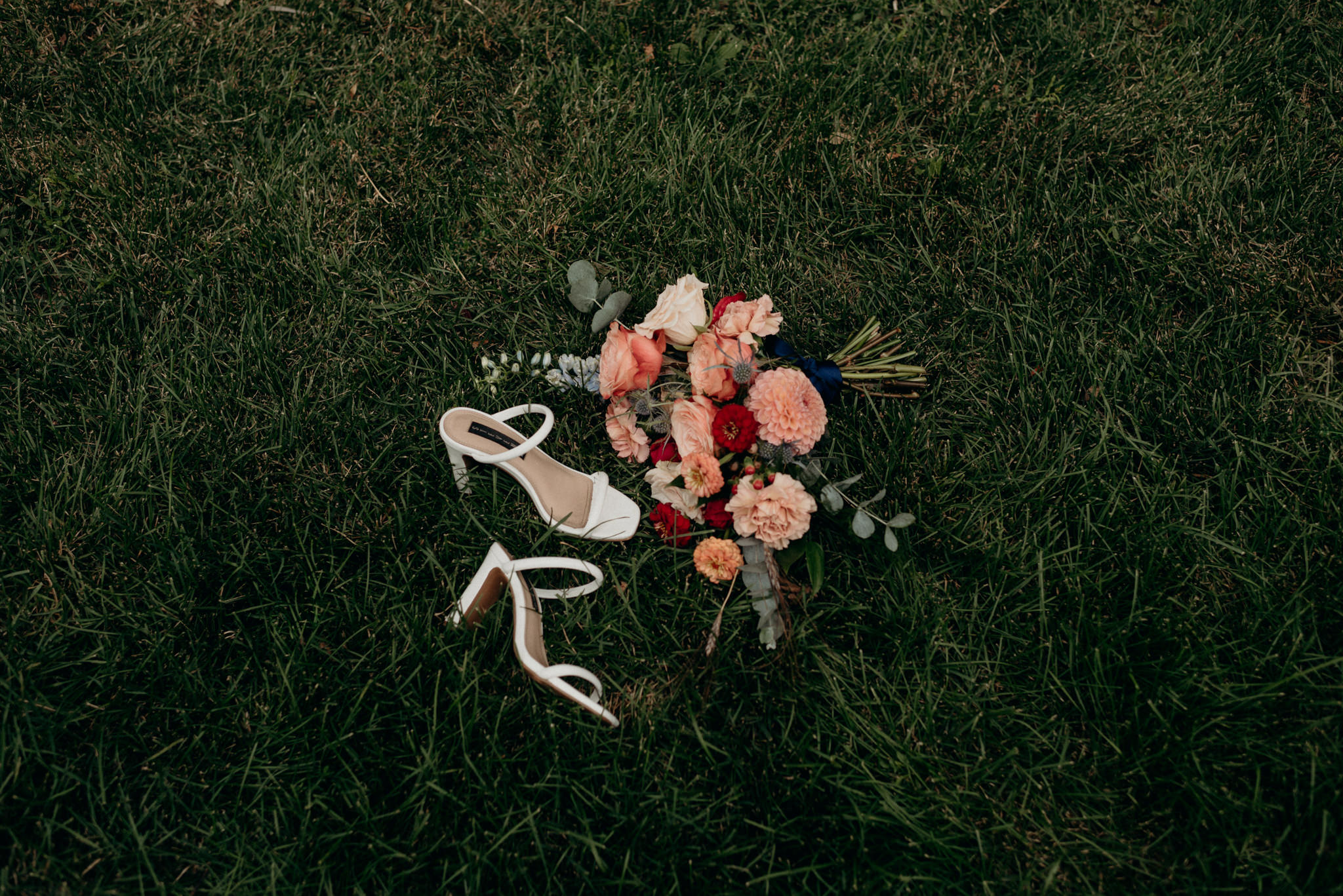 bouquet and shoes on the grass