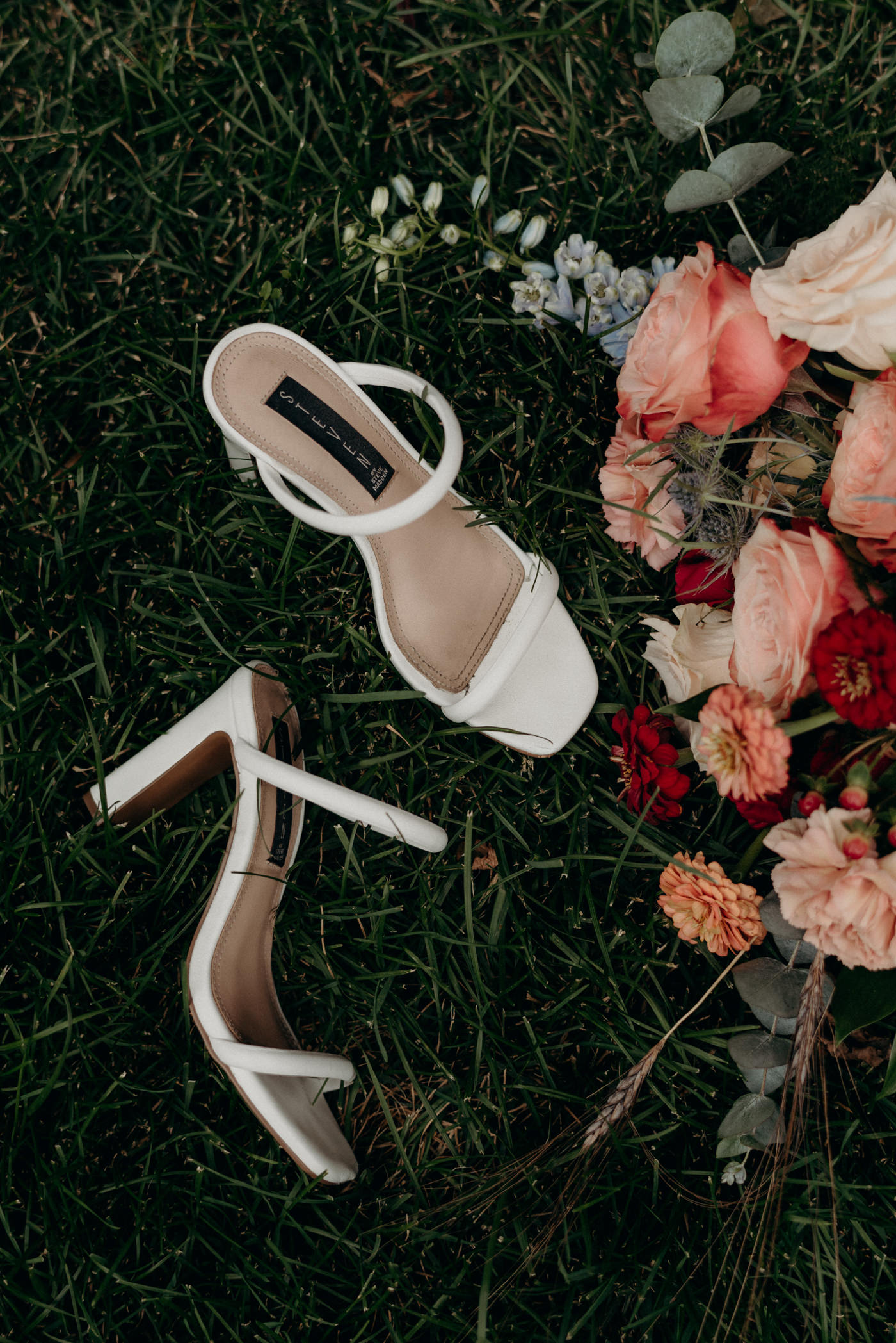 Shoes and bouquet in the grass