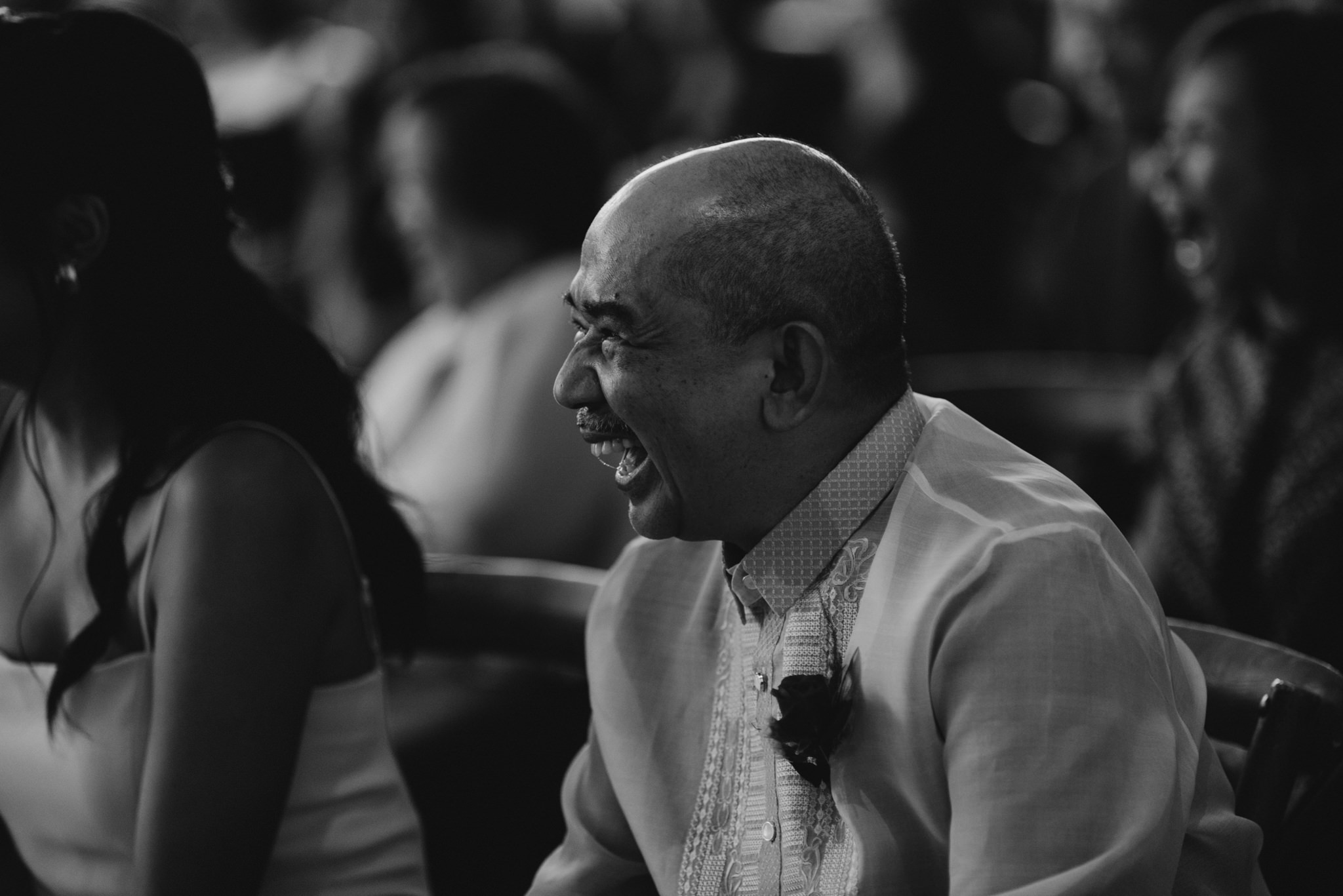 father of the bride laughing during wedding ceremony