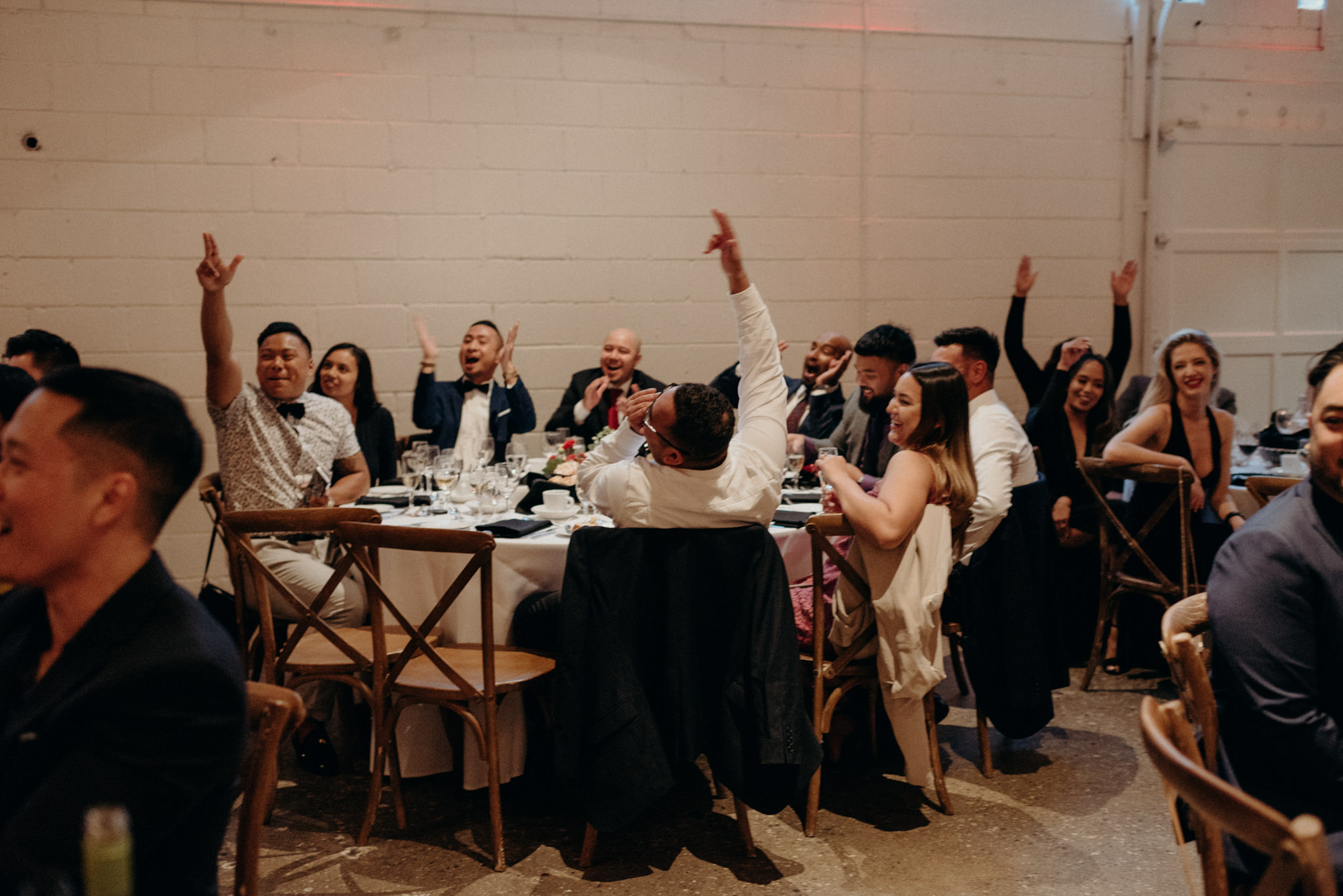 Guests cheering at wedding reception