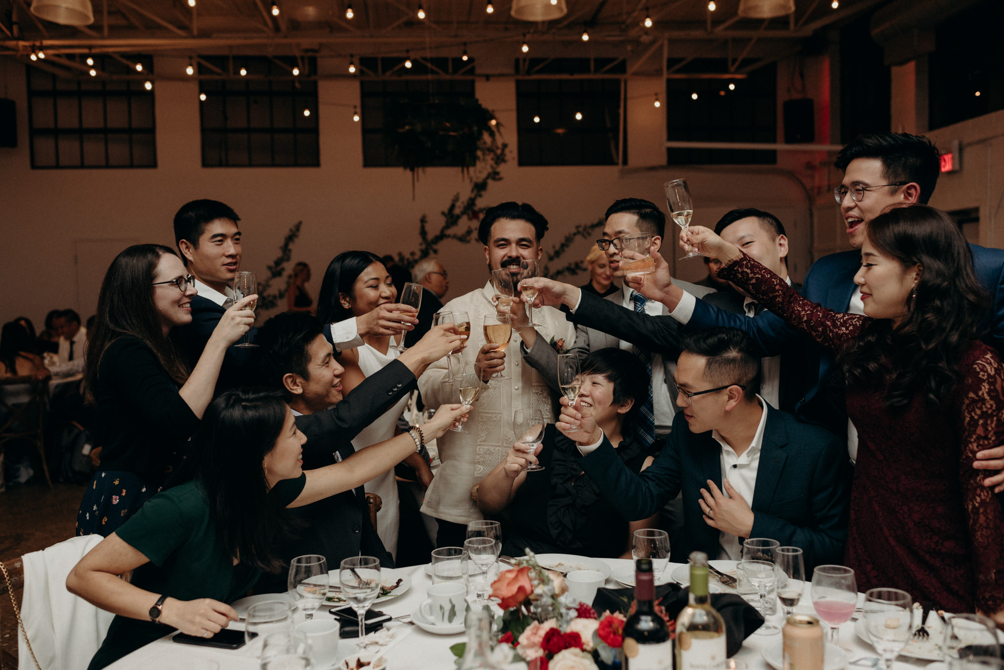 guests and couple drinking at reception