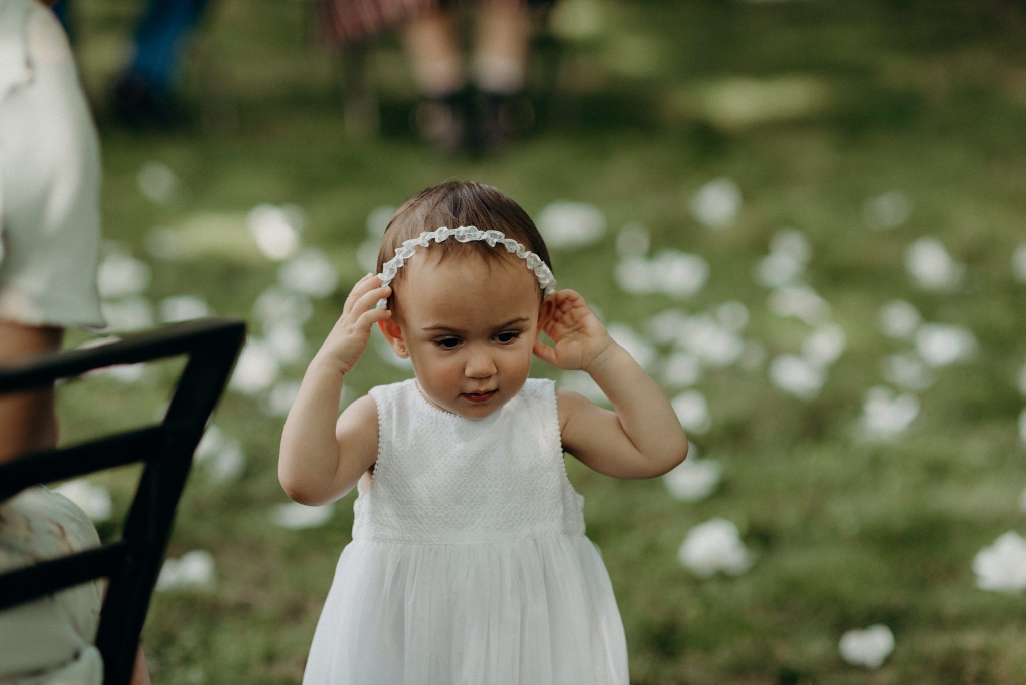 floral girl at backyard wedding