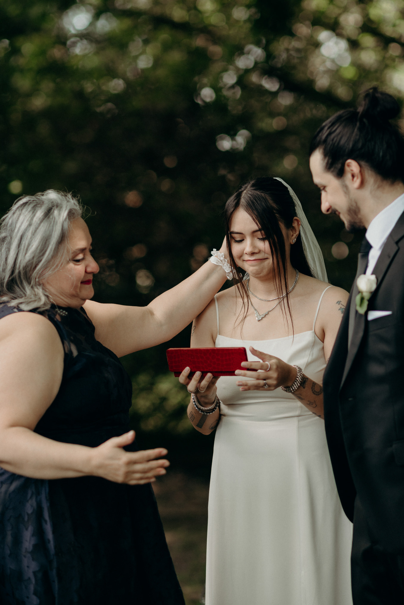mother of groom giving gift to bride
