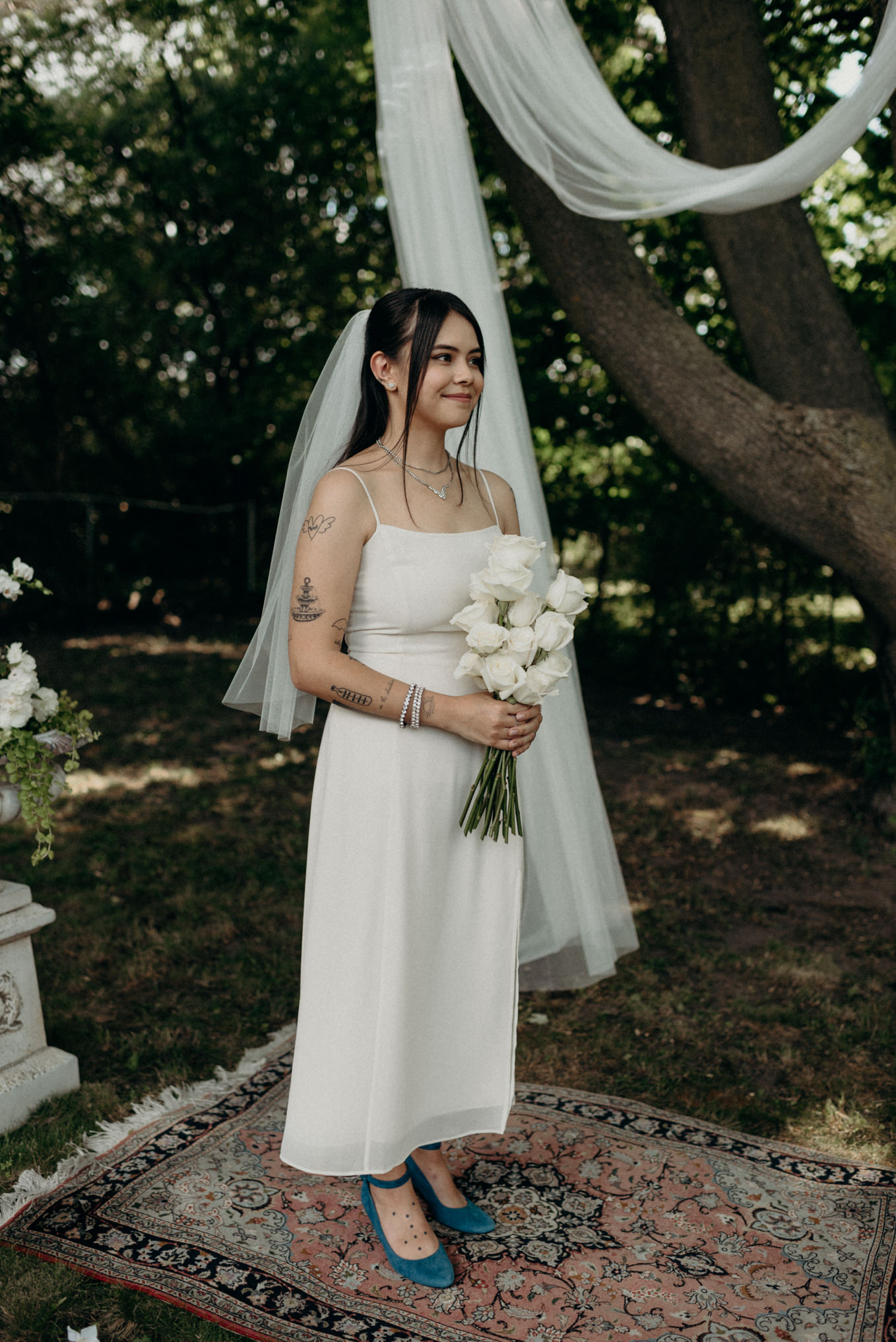 tattooed bride at outdoor ceremony