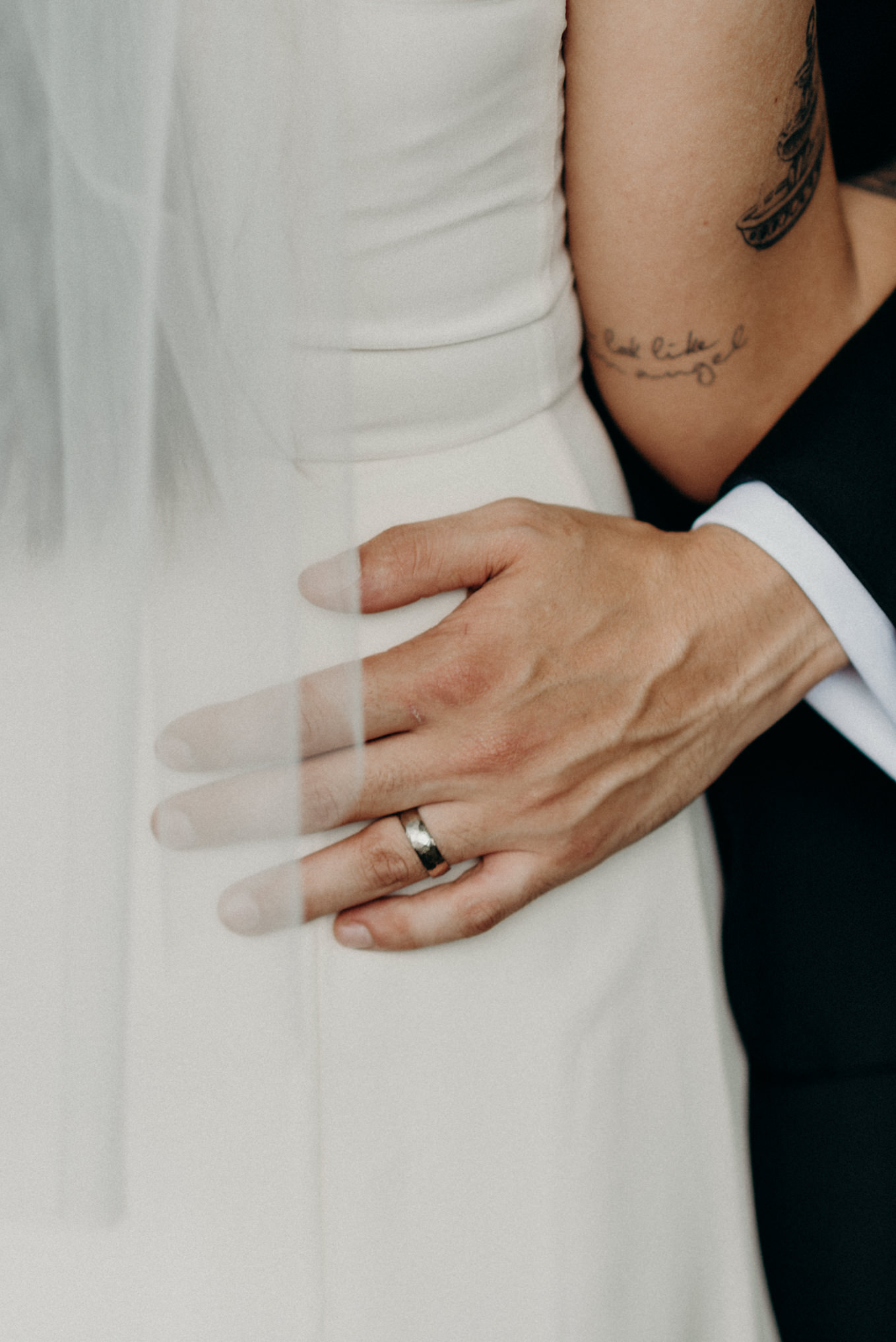 wedding ring on grooms hand