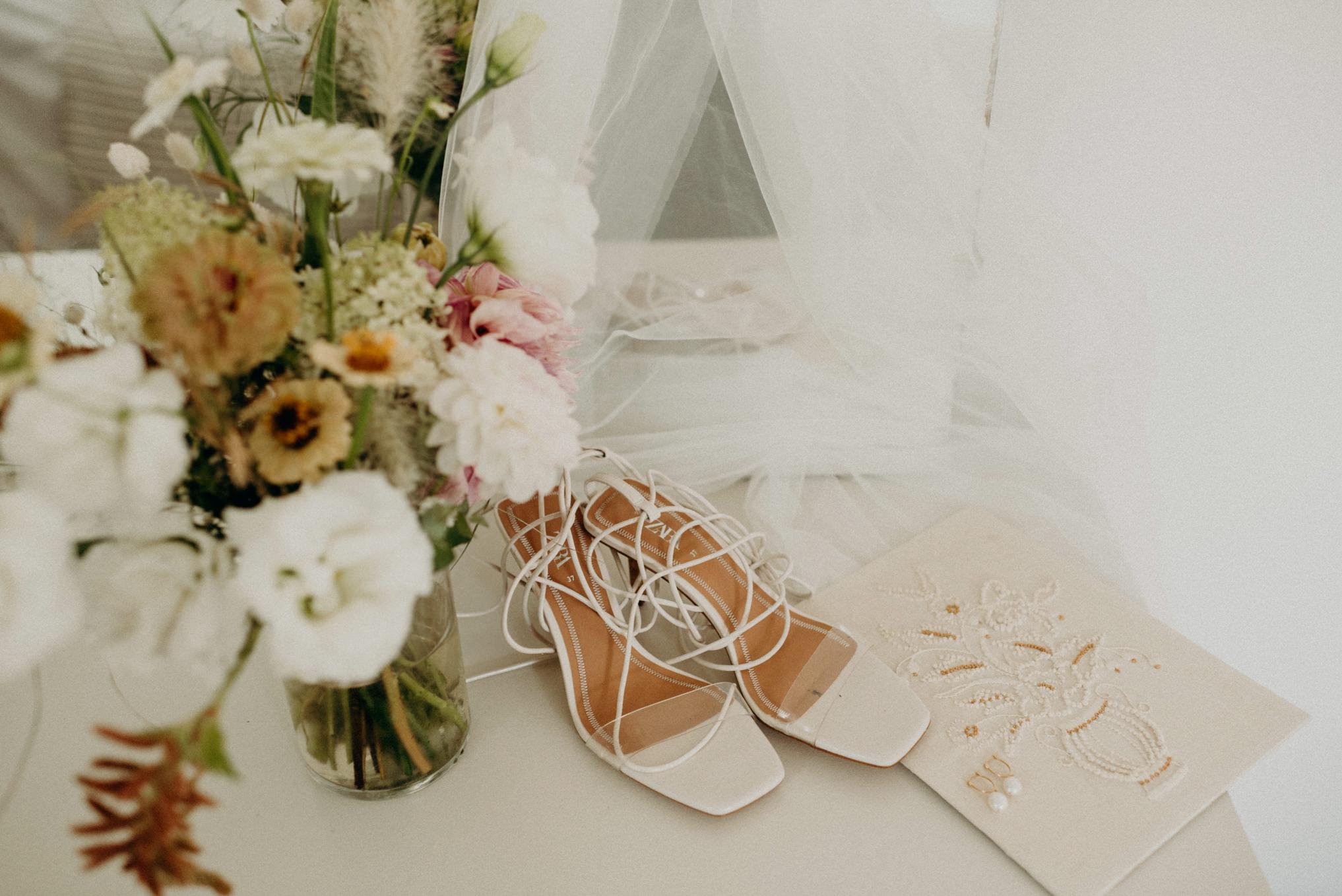 wedding shoes on white dresser