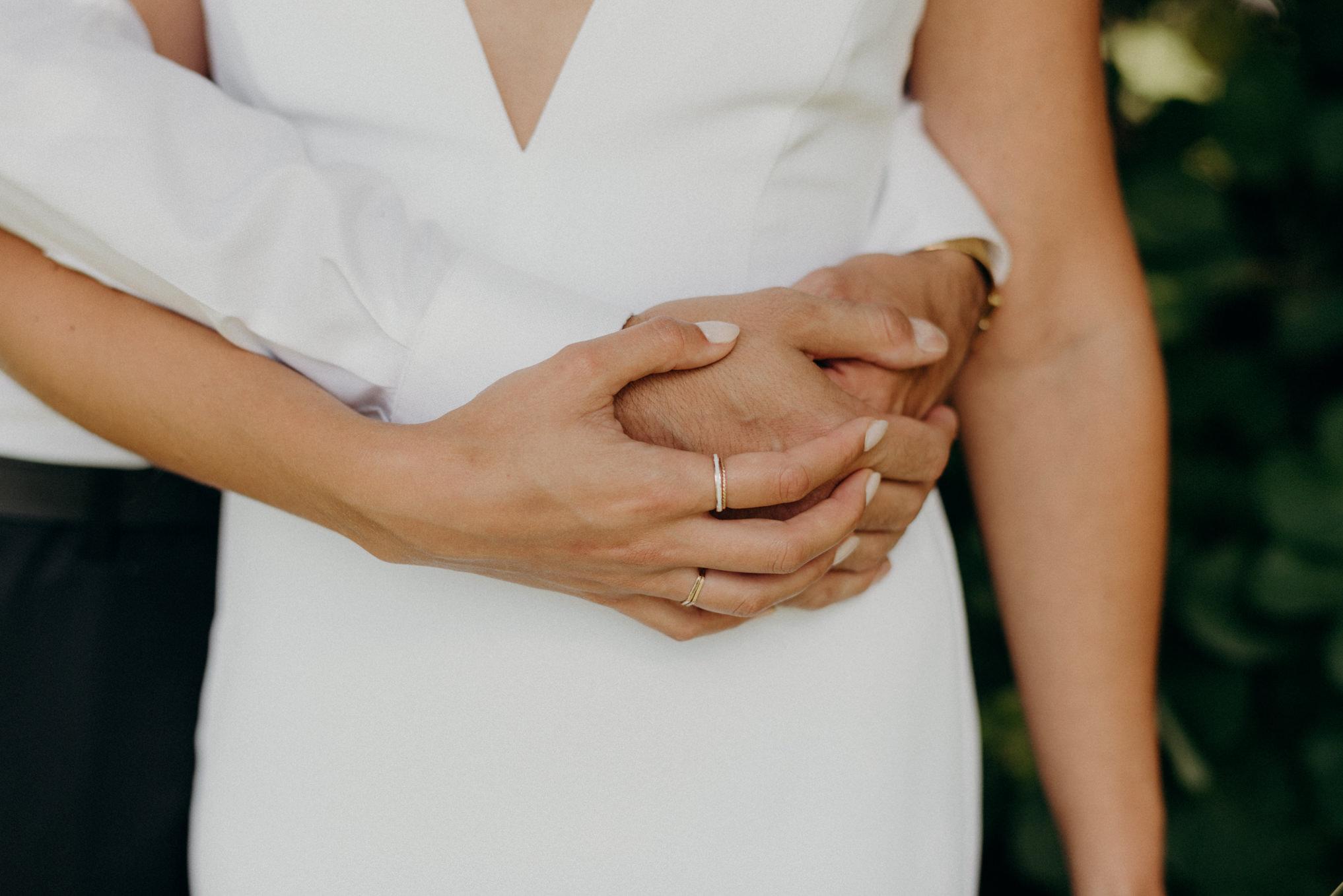 bride and groom hugging around waist