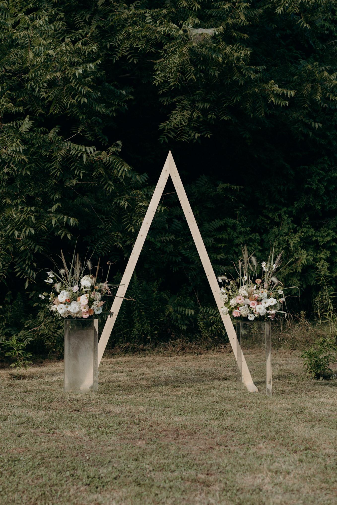 wood triangle ceremony backdrop diy