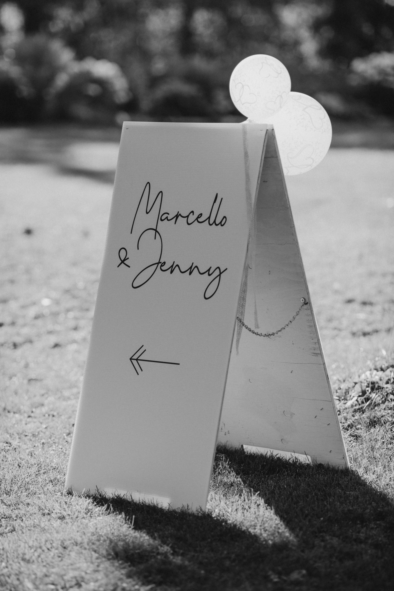 black and white sandwich board sign for wedding with balloons