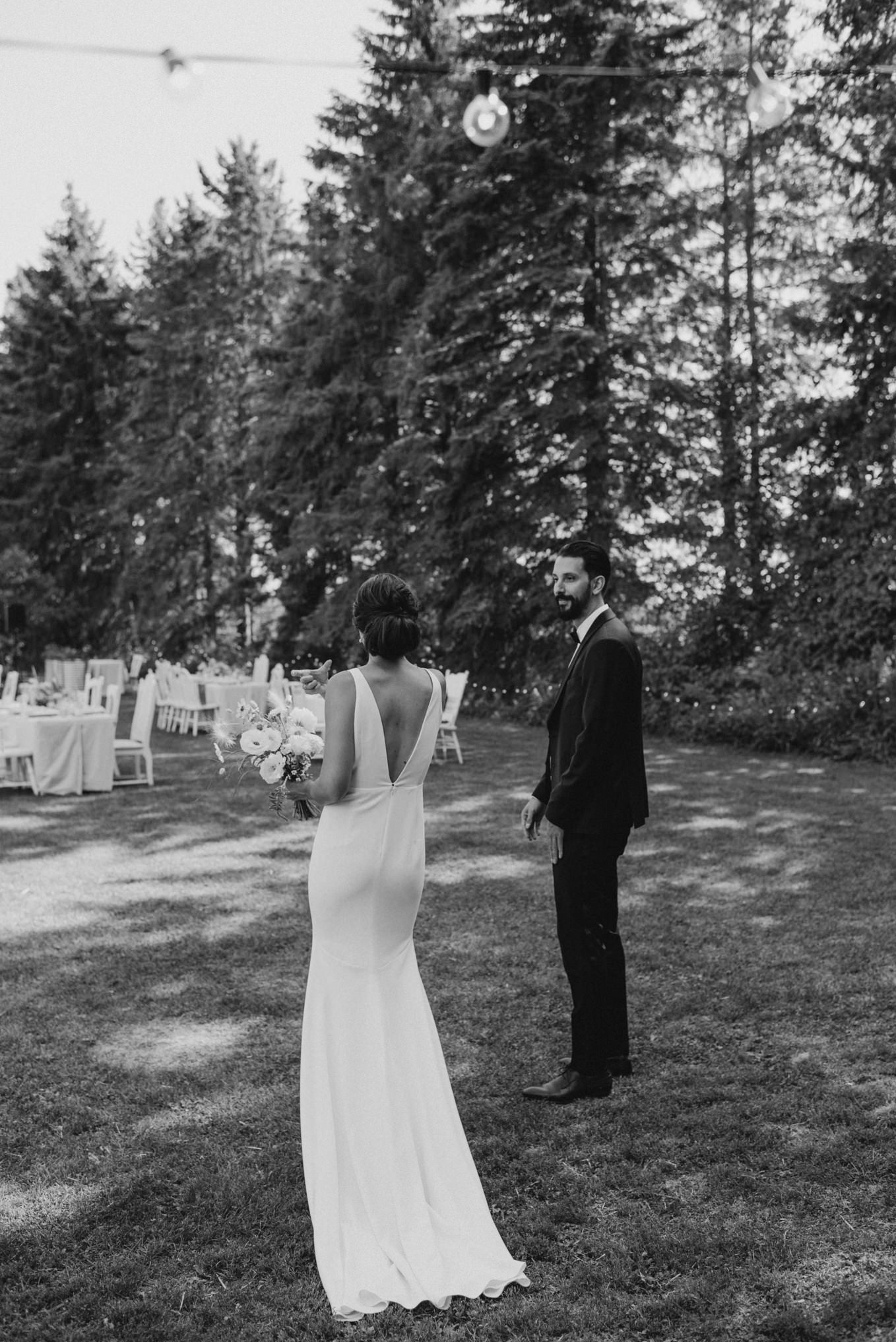 black and white photos of bride and groom on grass beside tables for outdoor wedding reception