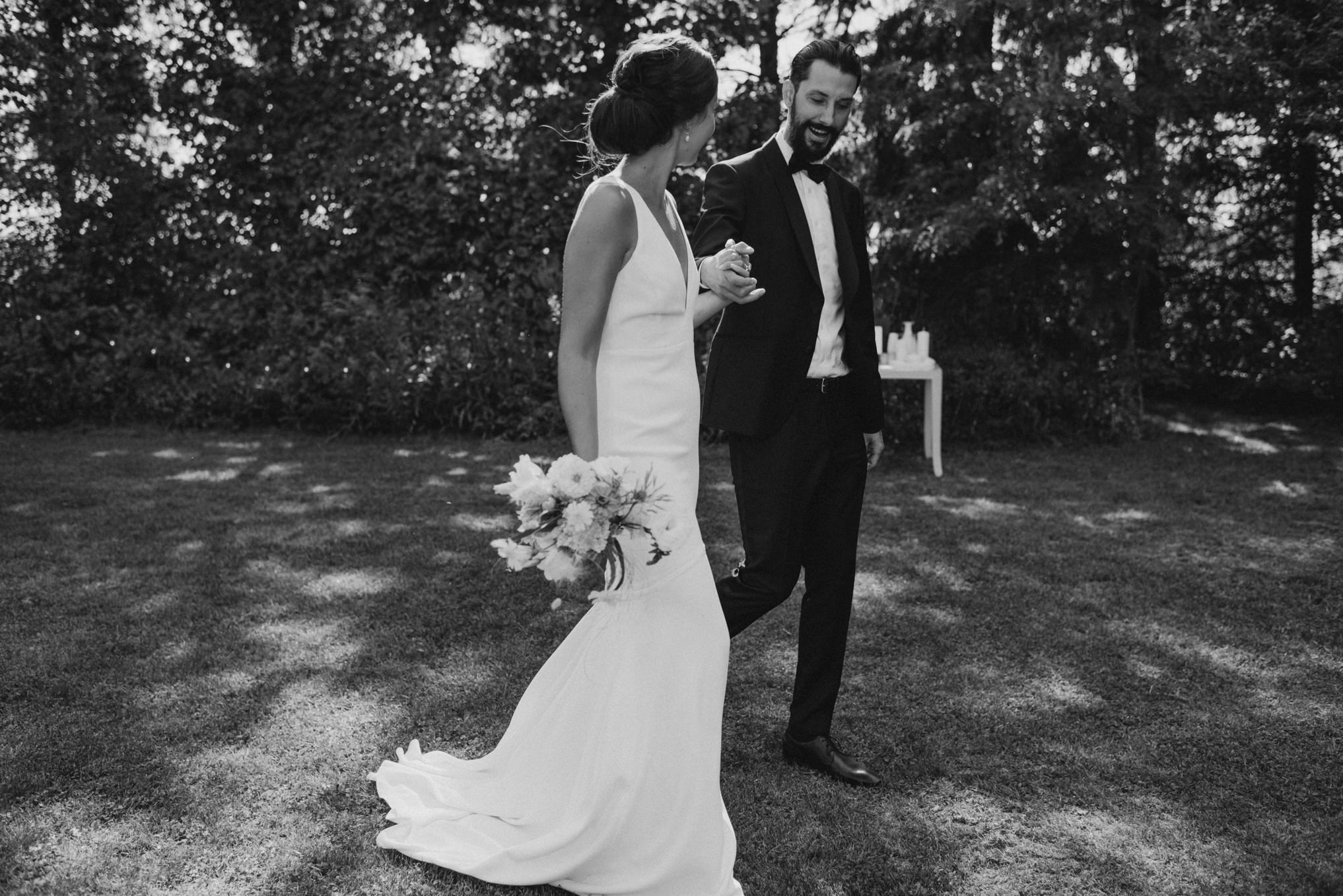 bride and groom walking on grass