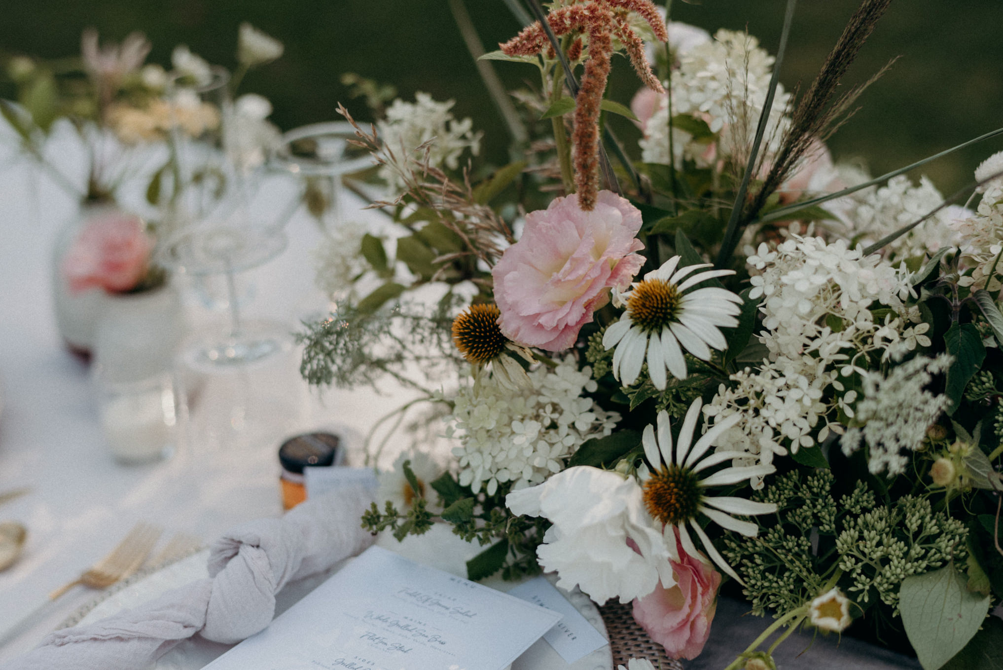 outdoor wedding reception table setting and flowers