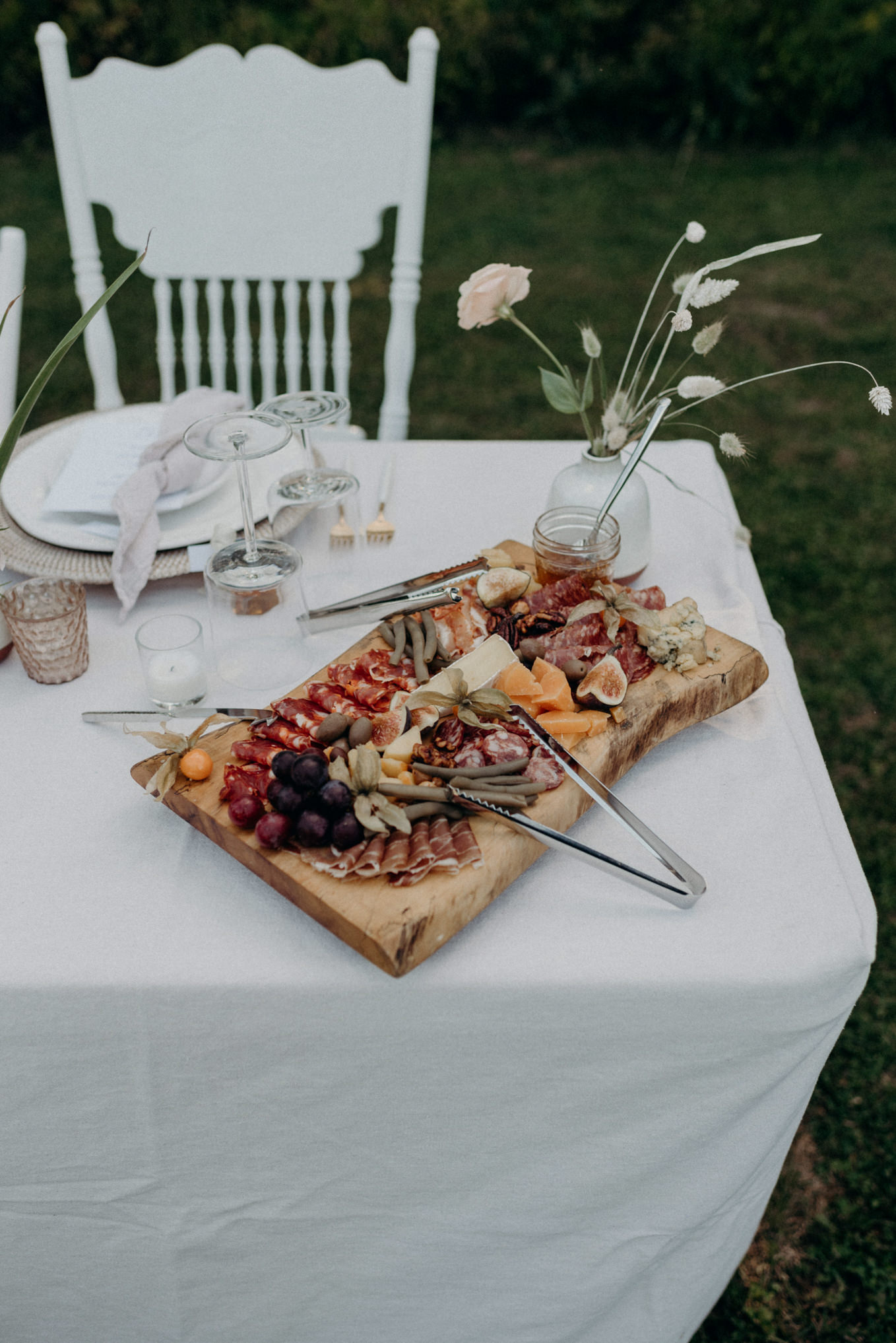 charcuterie on table for outdoor wedding reception