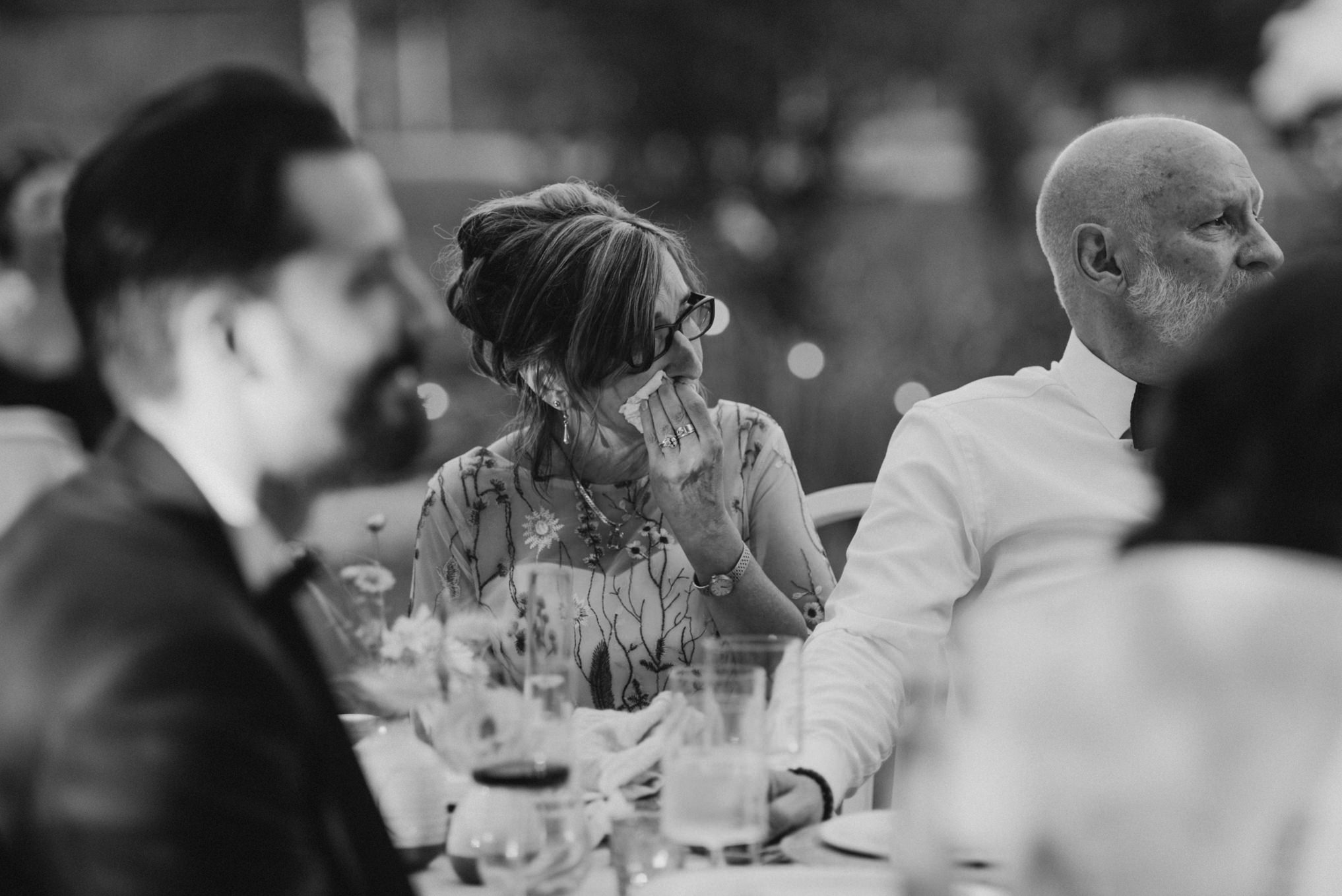 emotional mother during speeches at wedding