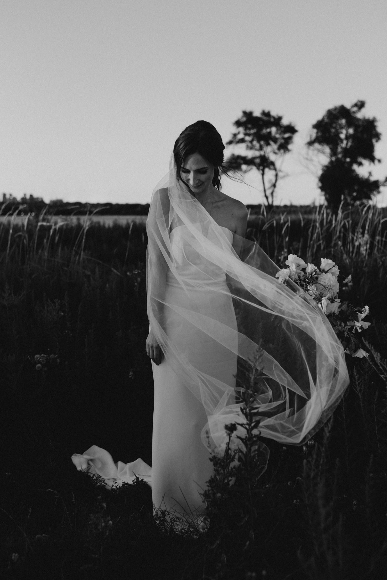 Bride with veil in wind at Humber Bay
