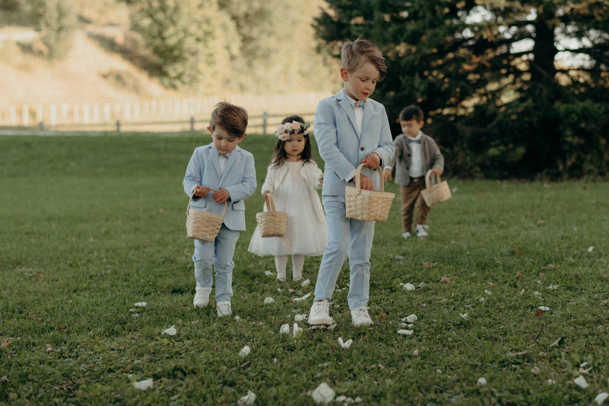 flower boys and girls walking down the aisle, outdoor wedding
